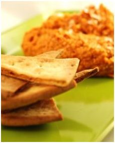 Sun dried tomato and garlic Hummus w/ Gluten Free Toasted triangles | Udi's® Gluten Free Bread