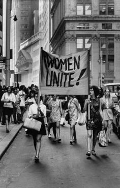 A photo of a women's rights protest that my character might have attended.