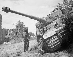 in 1944. Men from Durham Light Infantry Regiment inspecting a knocked-out Tiger tank