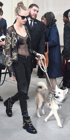 Cara Delevingne and Her Dog Leo Sat Front Row at Chanel's Haute Couture Show in Paris from InStyle.com