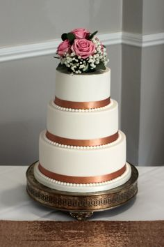 3 tier wedding cake with rose gold ribbon and fondant pearls decoration
