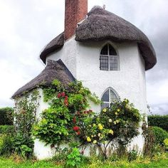 Quaint Storybook house with arched leaded windows and thatched roof Toll House. Cozy Cottage, Cottage Homes, Cottage Style, Irish Cottage, Cottage Bedrooms, Garden Cottage, White Cottage, Storybook Homes, Storybook Cottage