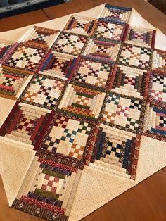 """Patchwork blocks, phase two is done! I don't rise and shine as much as I hit the sewing room and caffeinate. First phase of these """"split personality""""… Patchwork block with a plethora of plaids? Colchas Quilting, Log Cabin Quilt Pattern, Patchwork Quilt Patterns, Log Cabin Quilts, Patchwork Ideas, Crazy Patchwork, Patchwork Fabric, Patchwork Designs, Quilting Projects"""