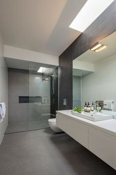 Hawthorn East bathroom renovation -- a little too sterile for me, but I like the shower door