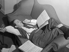 Walt Disney smokes a cigarette in 1939 as he checks over the musical scores that will eventually be used in Fantasia.