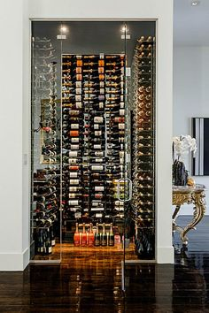3106 Ferndale St Houston, TX 77098: Photo A WALK-IN COMMERCIAL GRADE 400 BOTTLE WINE CELLAR WITH A SEPARATE SPLIT SYSTEM IS TUCKED AWAY BY THE ENTRY AND IS AS BEAUTIFUL AS A FINE WORK OF ART.
