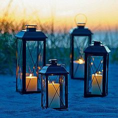Cross Bar Lanterns - Add a remote control or timer candle for easy use. Or, how about adding a wireless candle and using them for romantic beach lighting?