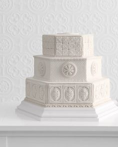 Beautiful formal wedding cake - Three-tiered hexagonal confection with sugar paste molded to resemble plaster details