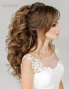 Featured Hairstyle: Elstile; Curly voluminous ponytail wedding hairstyle.