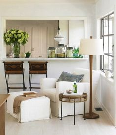 crisp and warm... i love a room devoid of color that has so much texture and warmth just from accessories