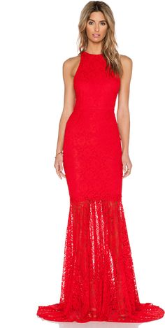 SAU SARA GOWN  $380 at Revolve Clothing          Available Colors: Red_WD7 Available Sizes: US 0/ UK 4,US 2/ UK 6,US 4/ UK 8 DETAILS Self: 100% nylon Lining: 95% rayon , 5% elastane Dry clean only Partially lined Lace fabric Asymmetric hem Hidden back zipper closure
