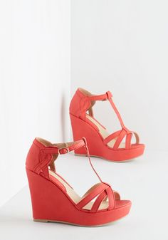 Platforms and Functions Wedge in Coral. Trekking through downtown, you swoon over the architectural splendor surrounding you in these T-strap wedges. #coral #modcloth