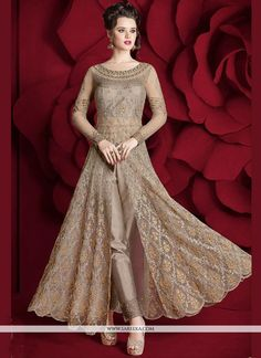 Be the dazzling diva clad in this beige net pant style suit with exquisite designs and patterns. The embroidered, resham and zari work on the attire adds a sign of beauty statement to your look. Indian Gowns Dresses, Indian Fashion Dresses, Gala Dresses, Indian Designer Outfits, Pakistani Dresses, Indian Outfits, Casual Dresses, Indian Clothes, Asian Fashion