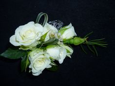 Corsage for wedding guest.  Made from spray ivory roses