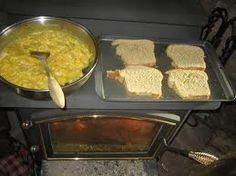 wood-stove-cooking tips and recipes from MOTHER EARTH NEWS You can use your wood stove for more than just heating your home. Here are some techniques and recipes to try for home wood stove cooking. Wood Stove Cooking, Fire Cooking, Cast Iron Cooking, Cooking Tips, Cooking Recipes, Cooking Pork, Cooking Games, Coleman Stove, Survival Food