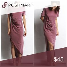 Gorgeous burgundy dress One of our favorite body design. Scrunch on the side as well as cuffed sleeves. Beautiful Washed Modal/cupro fabric. Fits like a charm  The model is 5'7 wearing a size Small. Dresses