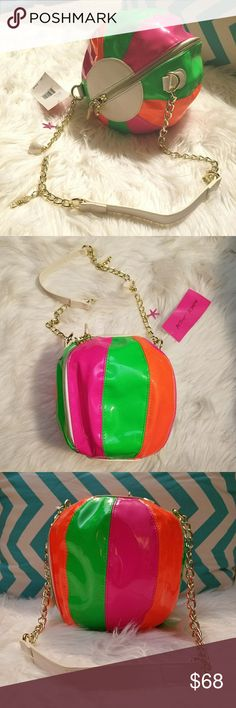 NWT Betsey Johnson Beach Ball Bag Purse NWT Betsey Johnson beach ball shaped bag with plenty of room. Has orange, pink, and green stripes. There are 3 charms on the chain strap, a sea shell, star fish, and sea horse. So cute!! Reasonable offers welcome! Betsey Johnson Bags Shoulder Bags