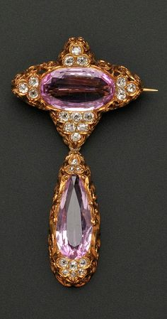 Antique 18kt Gold, Pink Topaz and Diamond Brooch, Retailed by Jones, Ball Poor, Boston, set with an oval-shape pink topaz with old mine-cut diamond accents, within scrolling foliate mount, suspending a conforming drop