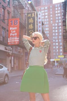 Green outfit ideas for spring // green stripe, gucci, adidas, and delpozo // How to wear sneakers with a skirt