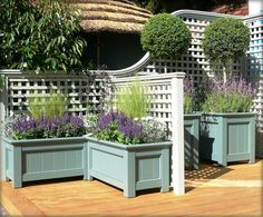trellis, planter boxes and stained or sealed wooden deck - lots of painting & project ideas here.Decorative trellis, planter boxes and stained or sealed wooden deck - lots of painting & project ideas here. Large Outdoor Planters, Wooden Garden Planters, Fence Planters, Small Patio, Outdoor Planter Boxes, Planter Pots, Fall Planters, Design Patio, Small Garden Design