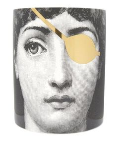 Fornasetti's iconic image of his muse Italian opera singer Lina Cavalieri is revitalised in this elegant metallic ceramic pot, which houses a divine Mistero candle.