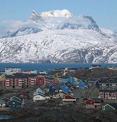 Greenland (about 80% ice covered) is the world's largest (non-continent) island, and it dominates the North Atlantic Ocean between North America and Europe It is geographically considered part of the North American continent.               Its sparse population is confined to small settlements along the coastlines, with nearly one-quarter of the population living in the capital city of Nuuk.