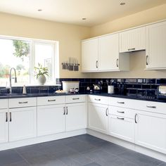 I have black countertops, and that wall color, think I need to paint my cabinets white now! Google Image Result for http://suadiye.info/images/black-kitchen-counter-tiles.jpg