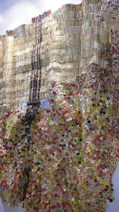 Stunning installation from El Anatsui. Love the repetition of form to create this stunning tapestry