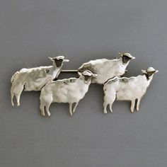 Flock of Sheep sterling silver pin. Art jewelry by Janet Kofoed.