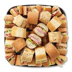 mini subs party platter cheese, pepperoni, ham, lettuce, pickles on french bread