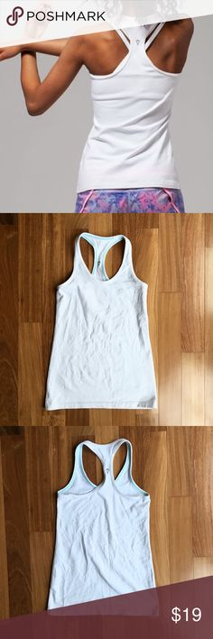 "Ivivva ""Keep Ur Cool"" Racer (by Lululemon) White tank from Ivivva line by Lululemon for Girls. Size 6. Sweat-wicking, four-way stretch Luon fabric. Form fitting. In excellent condition, no flaws. Fits 23-24"" chest, 21-22"" waist. *NOTE: this tank is for GIRLS, not WOMEN lululemon athletica Shirts & Tops Tank Tops"
