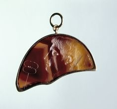 The Ionides Octavian, 35 - 27 BC. Attributed to: Solon. Agate, Height: 2.9 cm. Fragment of the upper section of a large oval brown agate plaque, known as 'The Ionides Octavian', engraved with the bust of Octavian (Augustus) with attributes of Mercury, as shown by the presence of a caduceus in the field, portrayed in the style of Ptolemaic royal portraits of the reign of Cleopatra VII. I British Museum