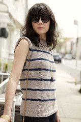 A perfect springtime sweater made in a summery cotton and sleeveless for warm weather days. Knit in the round bottom-up, then flat across the shoulders, this pullover is completely seamless! The stripes add a perfect nautical feel. Gauge given is for blocked swatches.