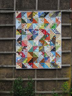going to use this pattern for a scrappy quilt from Everett's too-small clothes and fabric I've bought...love it!