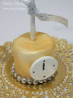 Sparkly marshmallow pops at a gold New Year's party!  See more party planning ideas at CatchMyParty.com!