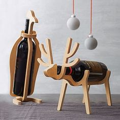 Reindeer and penguin Christmas wine racks!