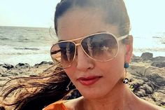 Sunny Leone looks beach ready sporting a high ponytail and some cool shades!
