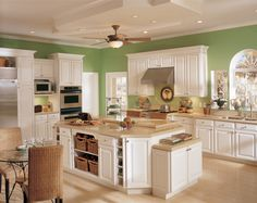 Kitchens With White Cabinets And Green Walls honey-colored pine cabinetry and dark green backsplashes give this