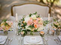 Natural linen; like mix of large, small, and tiny (one flower) arrangements; like tapers and mercury glass vases.