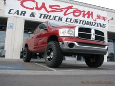 red dodge ram lifted truck