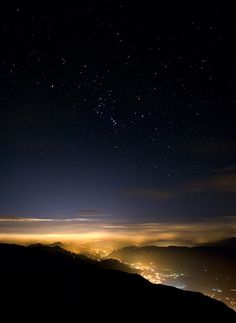 Orion over Turin - the small, fuzzy dot just below Orions belt is not a star, but a whole galaxy of stars
