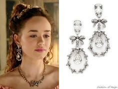 """In the episode 2x20 (""""Fugitive"""") Princess Claude wears Oscar de la Renta Crystal Bow Drop Earrings.You can find these earrings in black diamond color on Shopbop.com and MatchesFashion.com ($395).Worn with a Truly Zac Posen necklace."""