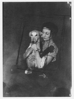 Man Ray. Woman with greyhound-like dog.