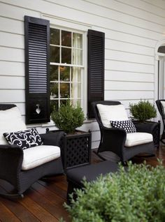 Paint shutters black to match wicker and black front door? would look great with white shutters and window sills and a grey house!
