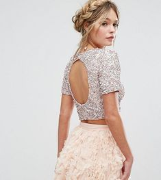 7e381b1c74e The gorgeous silver cropped top with embellishment open back co-ord from  Lace & Beads features a high neckline and capped straps, a fitted  silhouette and ...