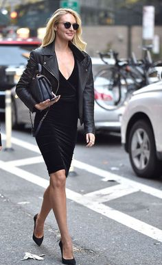 Swanepoel picked a form-fitting black dress and classic pumps that she toughened up with a black leather moto jacket