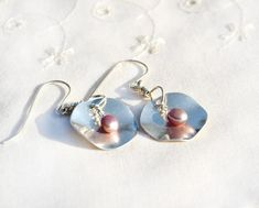 Lightweight Silver earrings with a colored pearl. Free shipping. HKart1, Israel. Feminine, shiny earrings featuring each an organic shaped round Sterling Silver sheet pendant (gauge 0.3mm.) ornate with a pink colored pearl. Suspended on Sterling Silver ear wires ending with a ball. Overall