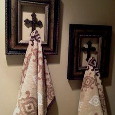 Towel Hooks In My Half Bathroom Cross Inside A Decorative Frame Artwork And