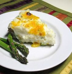 Cheezy Hamburger Pie with Garlic Mashed Potatoes via Cooking with K sounds good but no coriander for me. must try this soon, meat and tators
