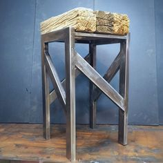Steel and reclaimed Barnwood beams make a barstool.  www.curtisfrankdesign.com
